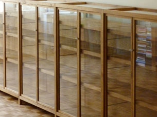 Book- and showcase in reclaimed oak and glass. All hardware is custom-made.