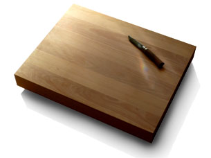Cutting board in beech, 8 centimeters in thickness, 50 by 60 centimeters, weight almost 20 kg.
